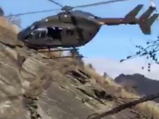 Flying into trouble? A still from video showing helicopters flying in  Skippers Canyon. Image:...