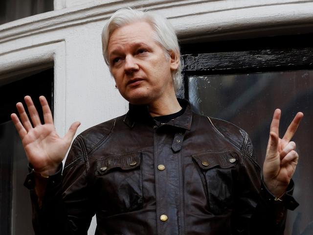 WikiLeaks founder Julian Assange addresses media from the balcony of the Ecuadorian Embassy in...