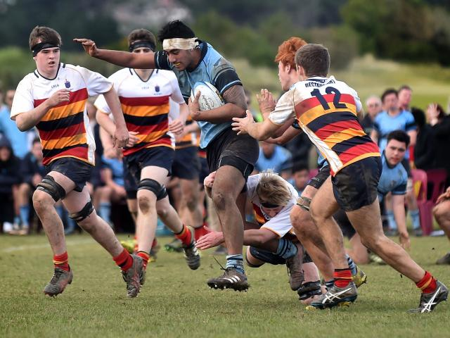 King's High  No 8 Logan Taimale makes a run as John McGlashan  defenders (from left) Oliver...