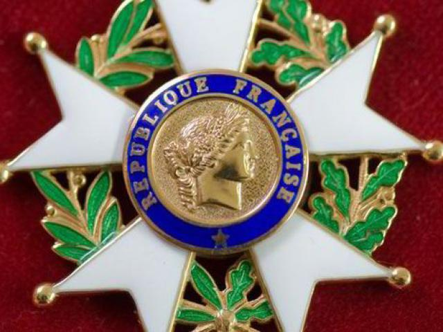 A close-up of the French Legion of Honour medal.