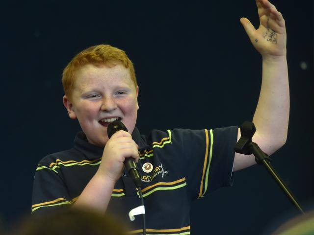 Archer Dovey finishes his song with a flourish during a school band rehearsal on Thursday. Photo:...