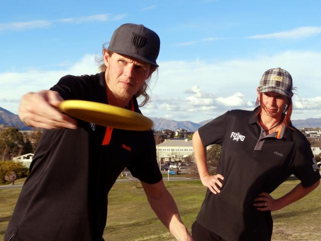 Disc golfers Kyle Martin and Hayley Flintoff get in some practice time at the Lismore Park disc...