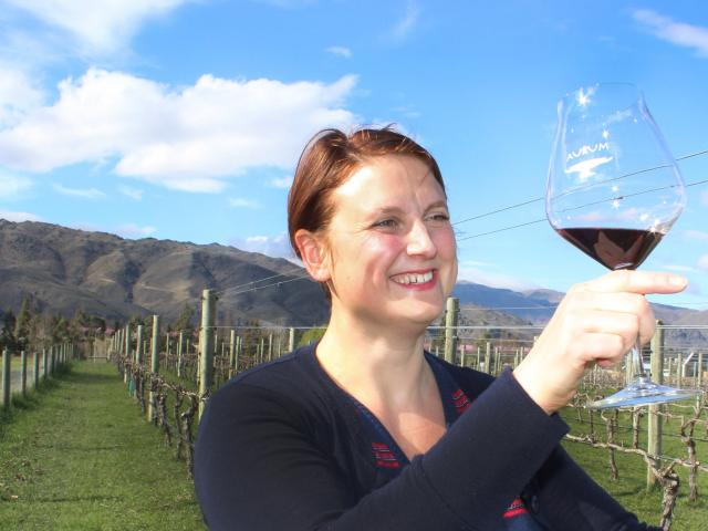Cromwell winemaker Lucie Lawrence, admires a pinot noir at Aurum Winery. PHOTO: JONO EDWARDS