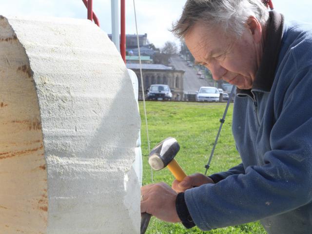 Dunedin sculptor Craig McLanachan works on a piece at the Oamaru Stone Symposium at Friendly Bay...