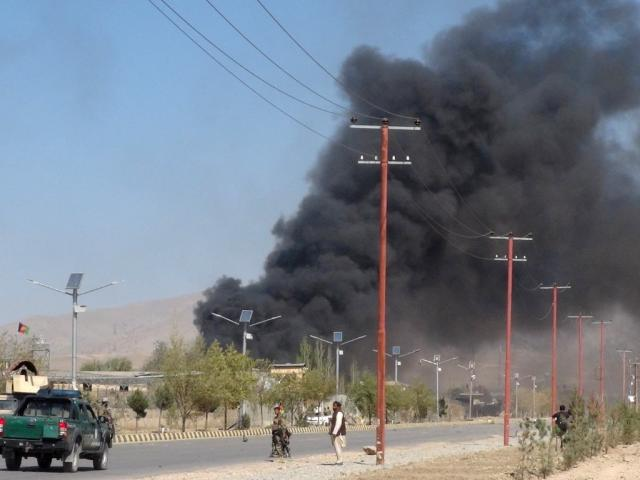 Smoke rises after a bomb attack on the provincial police headquarters in Gardez, the capital of...