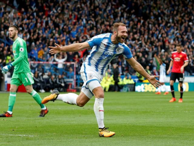 Huddersfield's Laurent Depoitre celebrates scoring their second goal. Photo Reuters