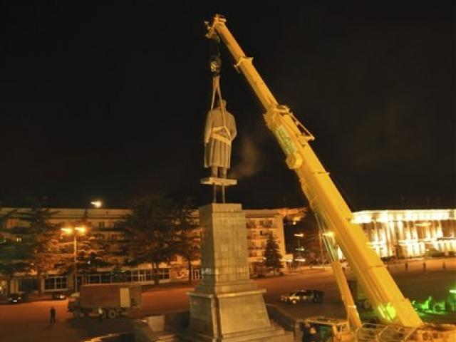 A statue of Soviet dictator Josef Stalin is dismantled at his home town of Gori, Georgia on...