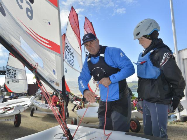 Sir Russell Coutts shows Oamaru sailor Will Plunket the ropes on his O'pen BIC craft sailboat at...
