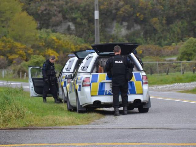 Police dog handlers on Stafford Loop Rd, just north of Arahura township where a 45-year-old man...