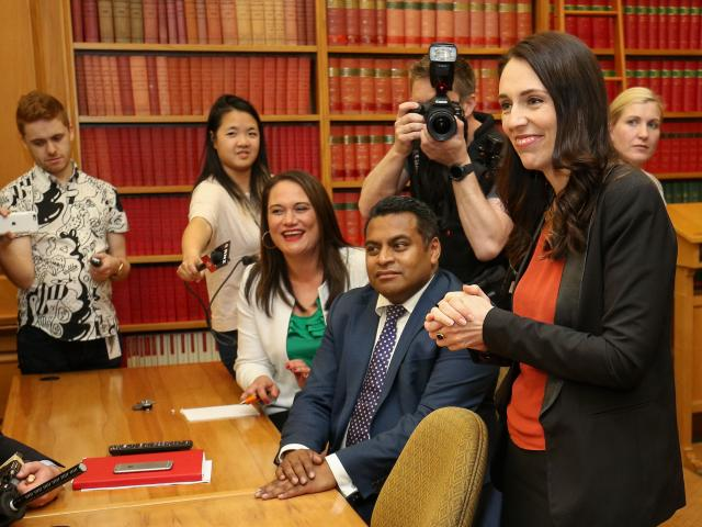 Labour leader and prime minister-elect, Jacinda Ardern, speaks to her MPs during a caucus meeting...