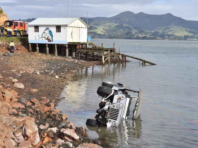 A Jeep crashed in to Otago Harbour this morning. Photo: Gregor Richardson