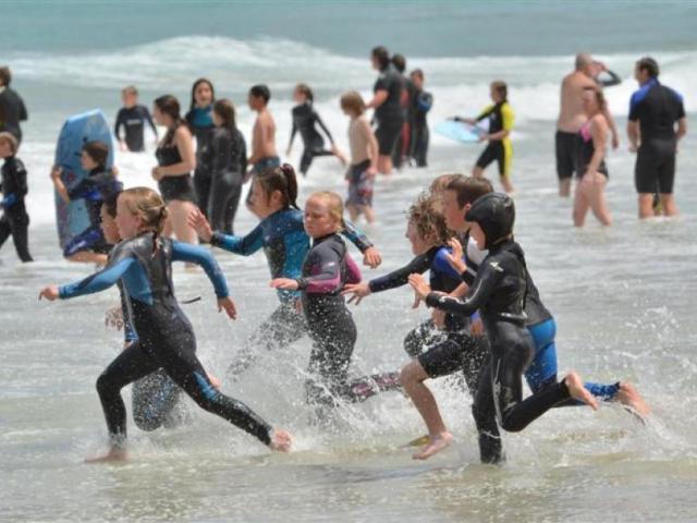 Children enjoy fine weather in Dunedin. Photo: ODT