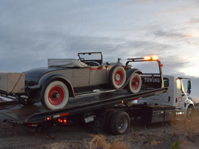 Craig and Nicky Marshall's 1928 Packard Roadster is towed to Los Angeles after breaking down on...
