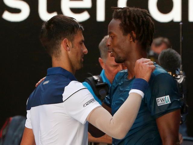 Novak Djokovic (L) and Gael Monfils embrace after their match. Photo: Reuters