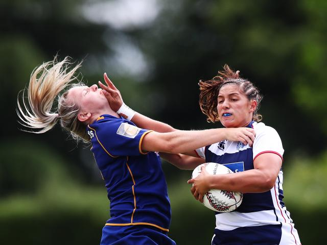 Auckland player Lara Diamond-Brahne fends off Otago's Zoey Flockton during the quarterfinals of...