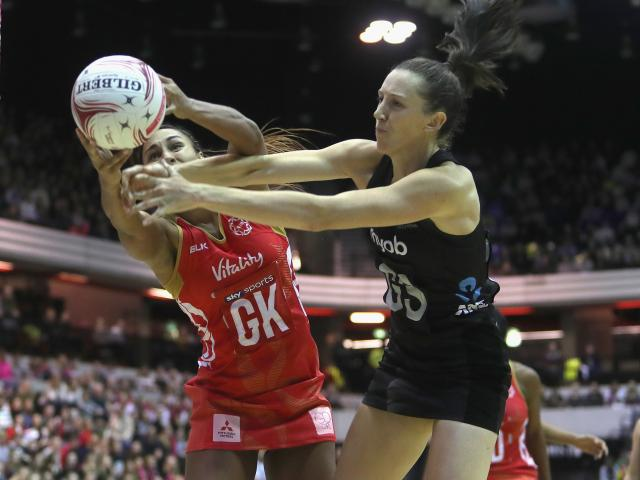 England's Geva Mentor (L) wins the ball from New Zealand's Bailey Mes. Photo Getty