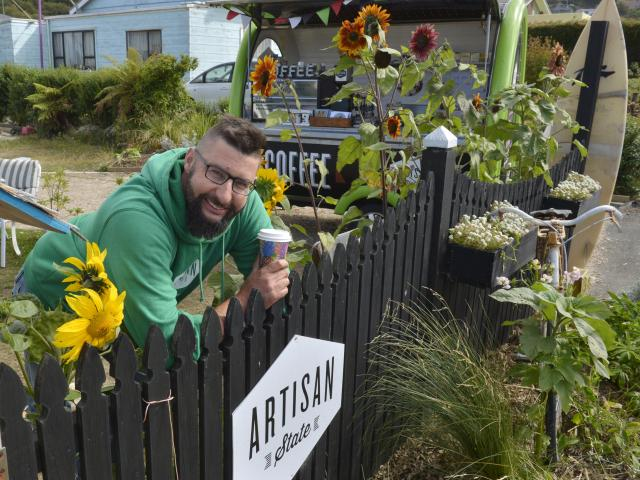Brighton coffee cart owner Andrew Barr samples some of his own take-away coffee at his ''Artisan...