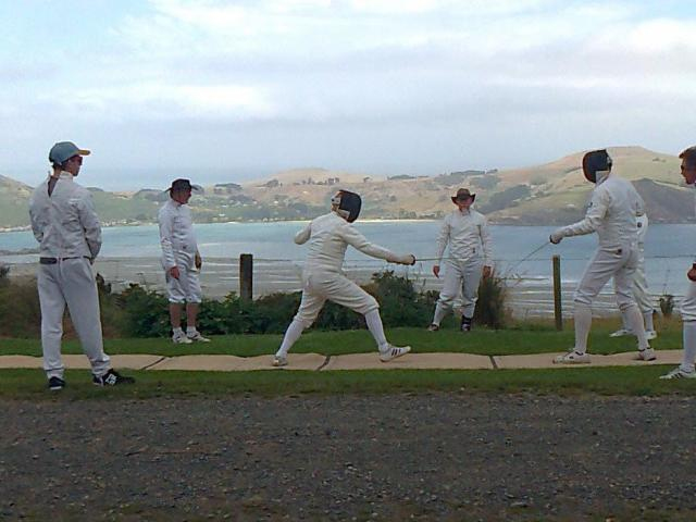Members of the Salle Angelo Fencing Club duel at Heyward Point during the club's opening day last...