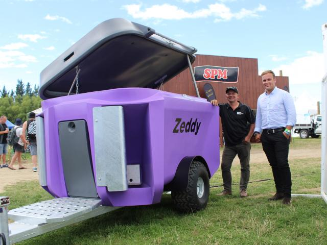 Zeddy team members Shane Parlato and Pearse McGoughan show off the Zeddy 1250 Dry Feeder, which...