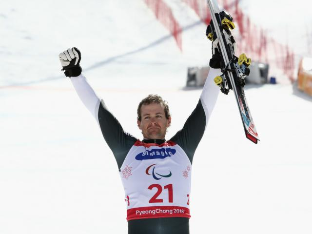 Adam Hall celebrates during the victory ceremony. Photo: Getty Images