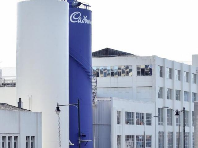 Production workers at Cadbury will clock off for the final time at midday today, on the eve of...