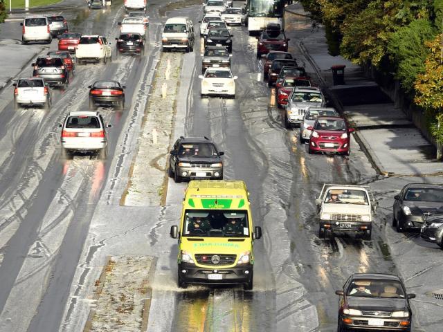 An ambulance crawls through the slush on Stuart St. A short but sharp hailstorm yesterday...