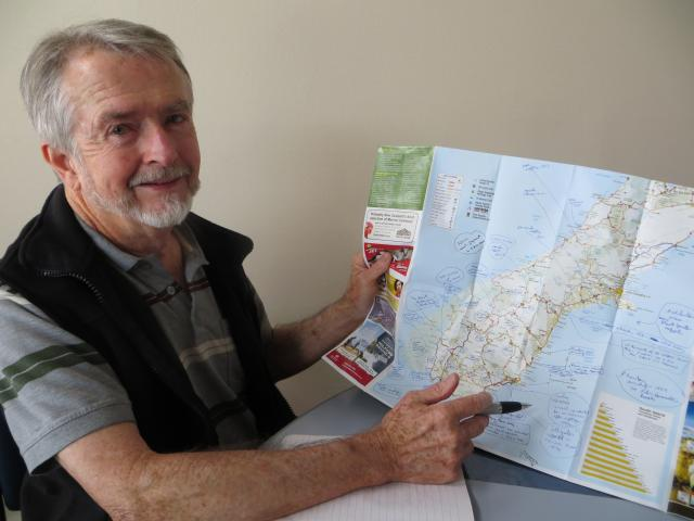Author Tony Healy with his South Island map pinpointing unexplained sightings. Photo: Toni Williams