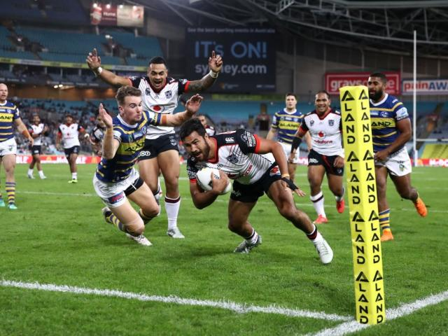 Peta Hiku scores for the Warriors against the Parramatta Eels in Sydney at the weekend. Photo:...