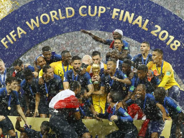 France's Hugo Lloris lifts the trophy as they celebrate winning the World Cup. Photo: Reuters