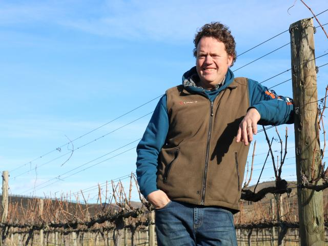 Central Otago Winegrowers Association spokesman James Dicey beside his finished crop for the year...