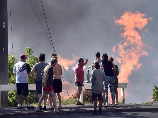 Residents watch Burnside burn from Mulford St, Concord, in January. Photo: Peter McIntosh