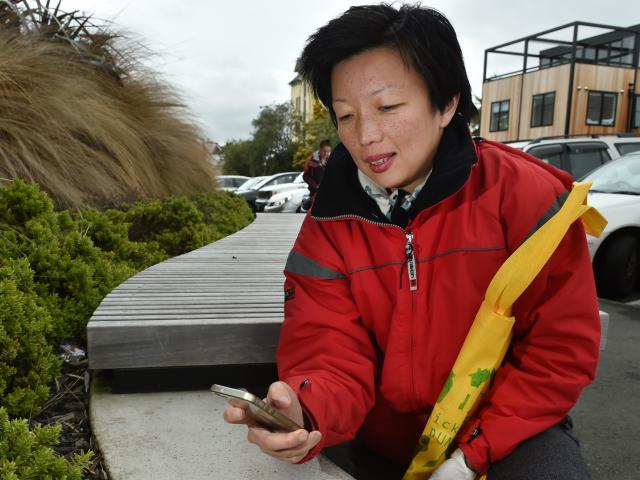 Siau-Jiun Lim photographs litter for her art project in Forth St on Monday afternoon. Photo:...