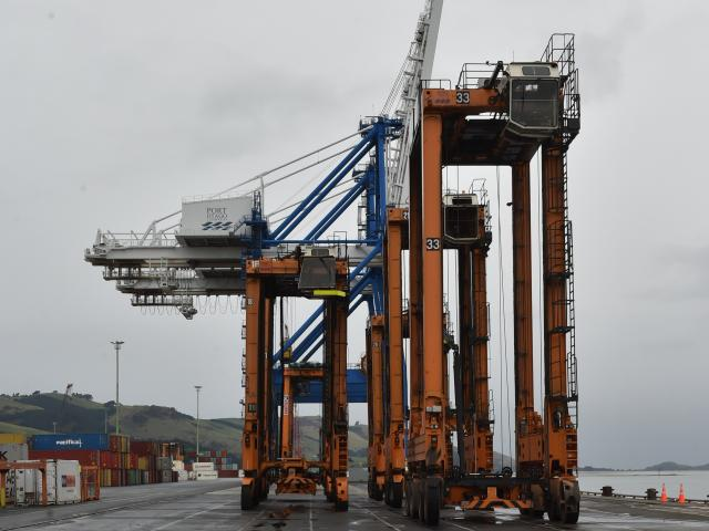 Port Otago's  Finnish-made Kalmar straddle carrier ''No 18'' is next in line to be gas-axed apart...