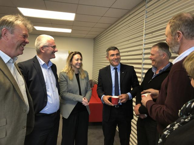 National's agriculture spokesman Nathan Guy (centre) and Invercargill MP Sarah Dowie, talk with agribusiness representatives in Invercargill last week. Photo: Supplied