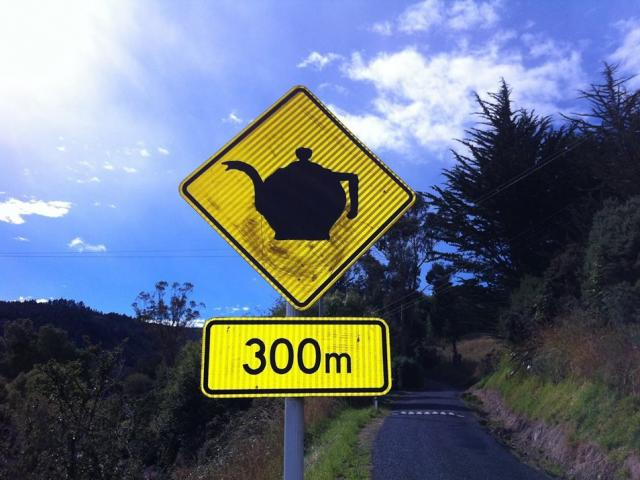 """A """"modified"""" sign in Waitati expresses a sense of community. Photos: Supplied"""