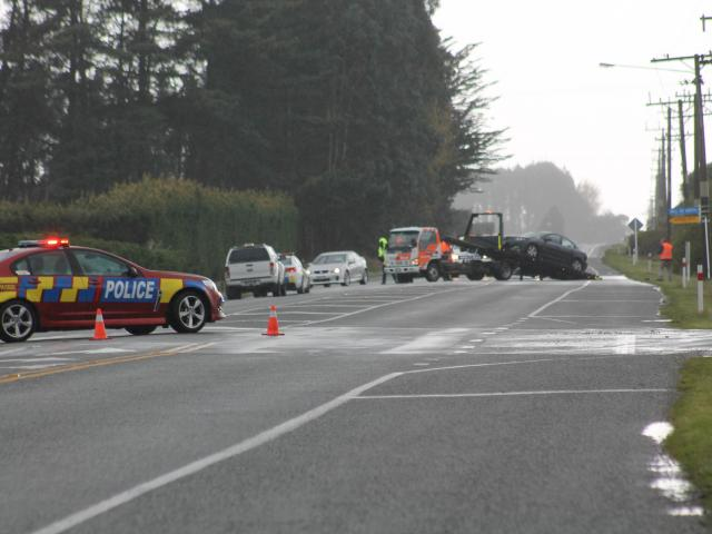 A car gets towed following a two-car crash in Invercargill this morning. Photo: Sharom Reece