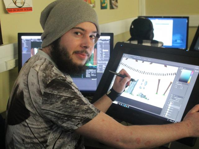 Game developer Nik Bartlett (20) works on his endless-runner game Supreme Mech Panda for the...