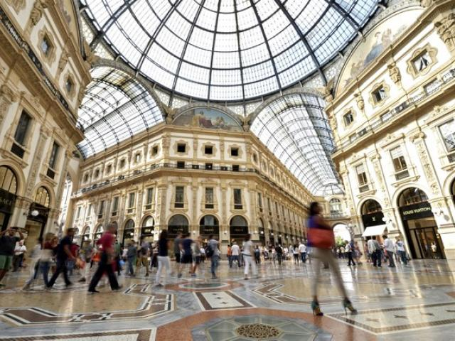 People walk along the Galleria Vittorio Emanuele II shopping mall in Milan. Photo: Reuters
