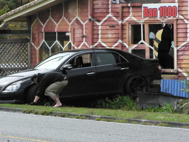 A driver lost control on a roundabout, causing the car to go backwards through the front window...