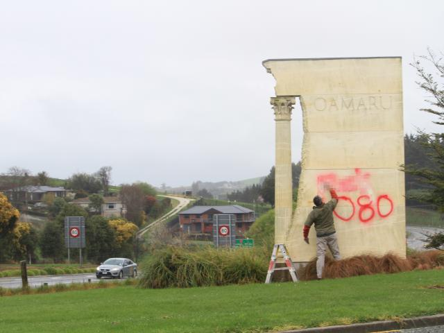 The graffiti painted onto the Oamaru entrance sign. Photo: Hamish MacLean
