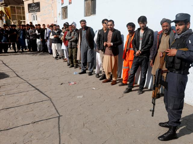 Afghan men line up to vote in Kabul, Afghanistan. Photo: Reuters