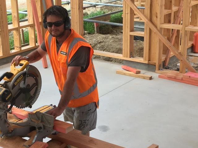 Brett McEwan (34) is one of many adults completing an apprenticeship with Breen Construction....