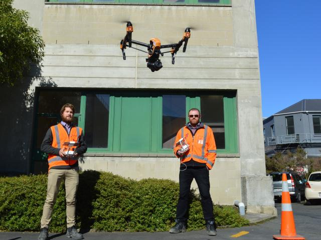 WSP Opus  drone  pilot Scott Kvick (left) and senior structural engineer Dave Ellis use a drone...