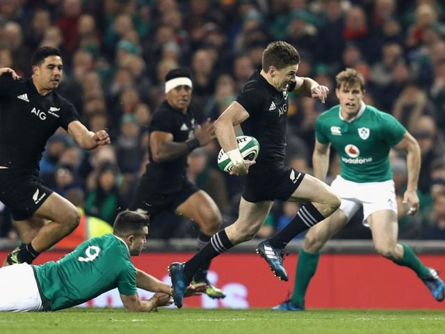 Beauden Barrett skips out of a tackle during the All Blacks' 2016 encounter with Ireland. Photo:...