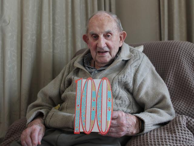 Southland man Tom Johnstone shows one of the many cards he received ahead of his 100th birthday....