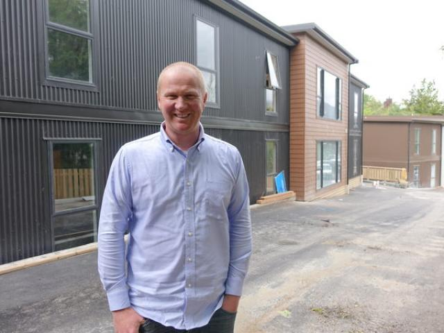Bus driver and property developer Simon Haslett has helped charity workers move into new...