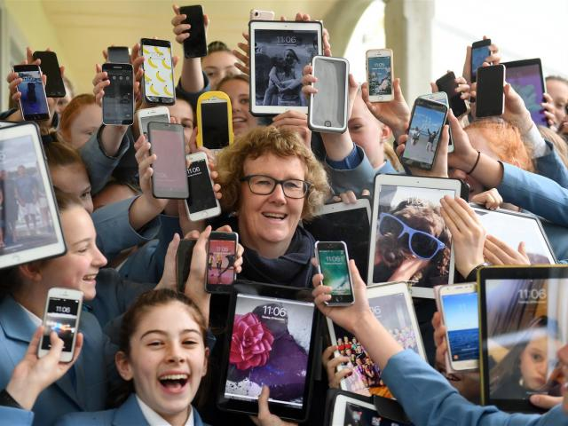 St Hilda's Collegiate principal Jackie Barron amid a sea of cellphones and tablets that will be...