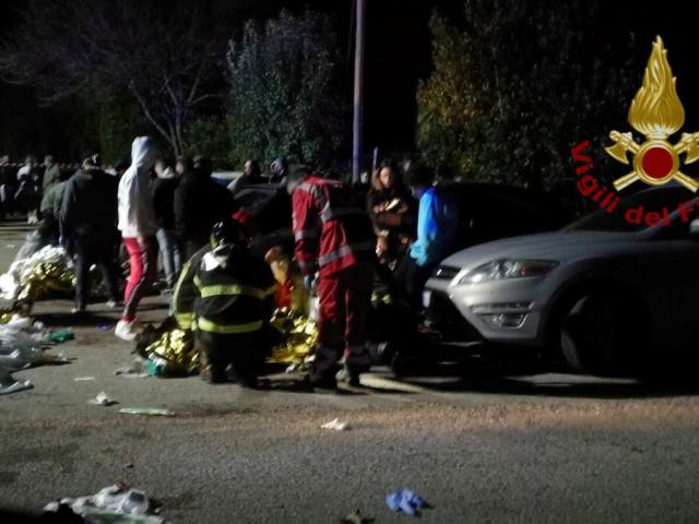 Emergency personnel attend to victims of a stampede at a nightclub in Corinaldo, near Ancona,...