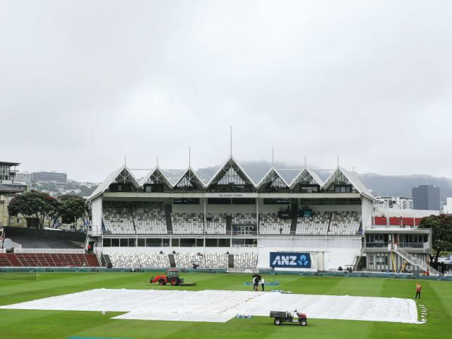 Covers lie on the wicket during a rain delay on day five of the first test match in the series...