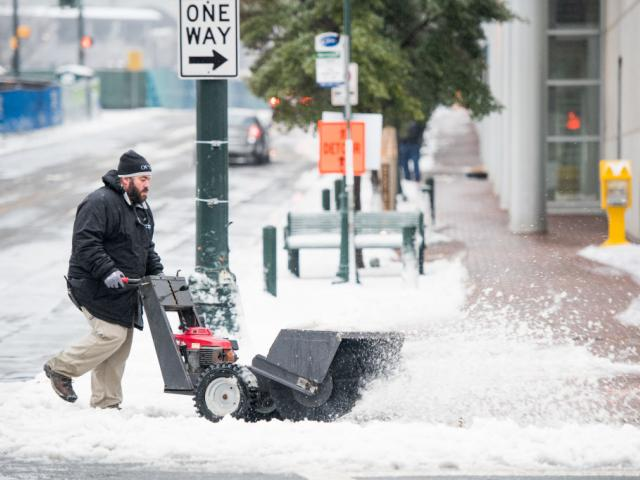 A man operates a snow sweeper in Charlotte, North Carolina. Photo: Getty